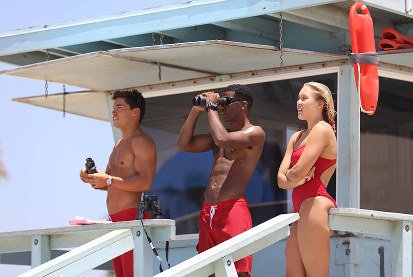 Three lifeguards watching for the publics safety.