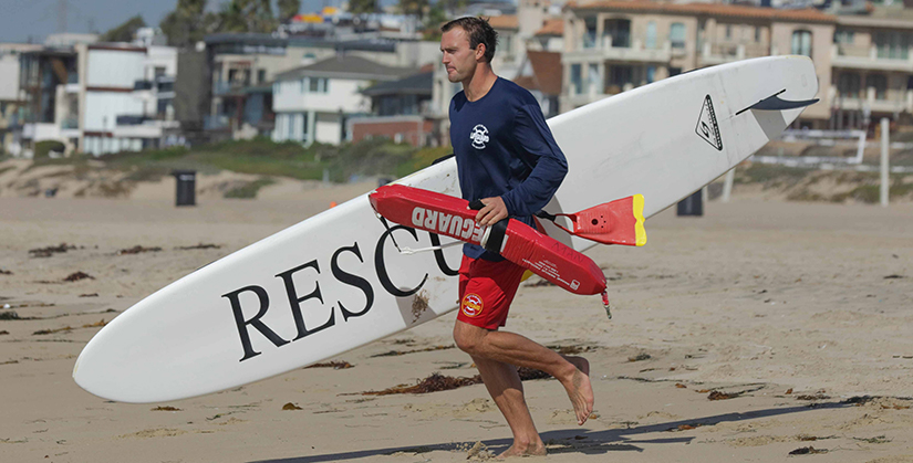 Lifeguard getting ready to enter the water.