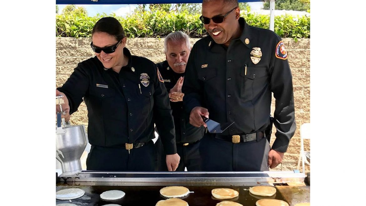 Chief Osby serving up pancakes.