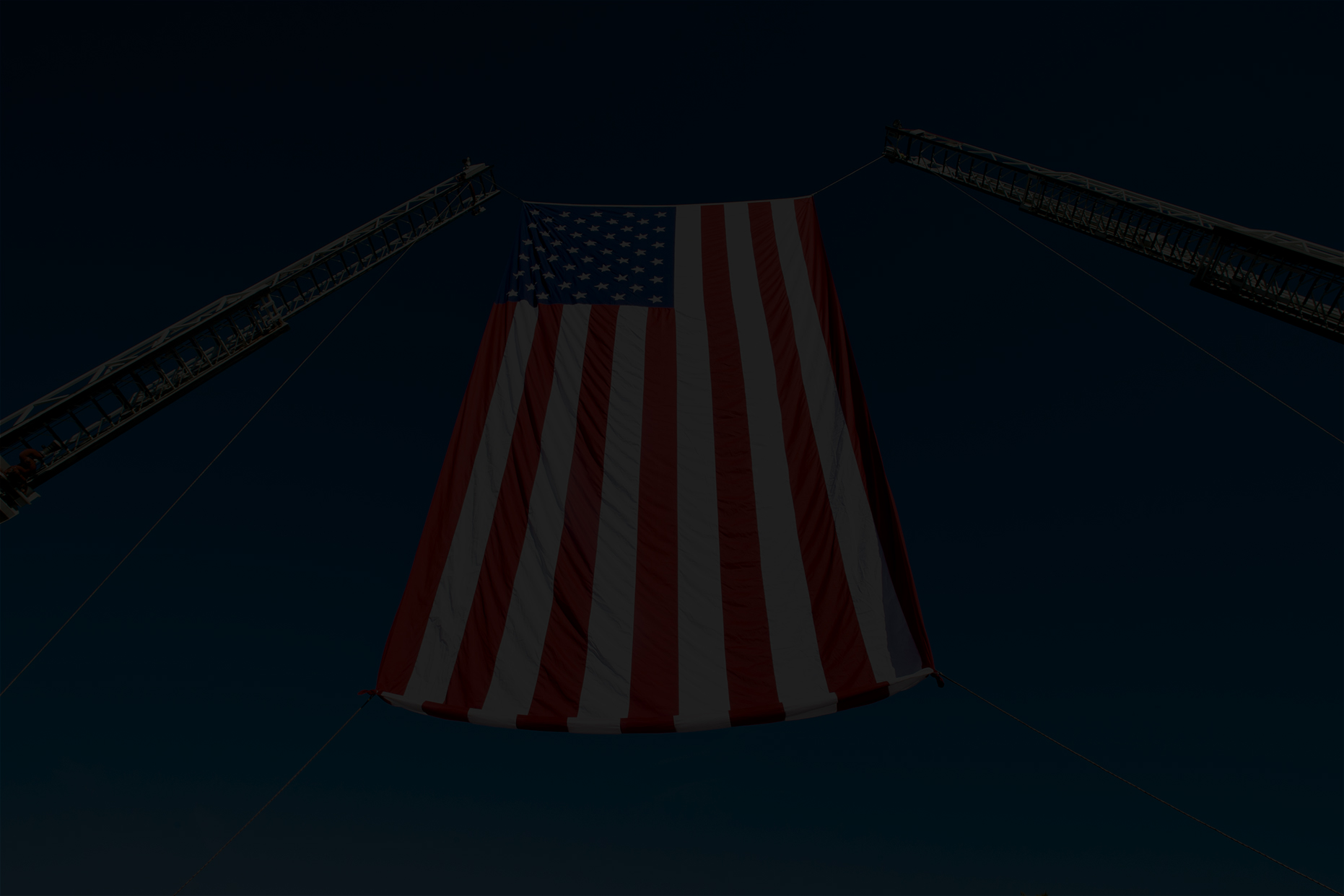 image of a darkened American flag for a background.