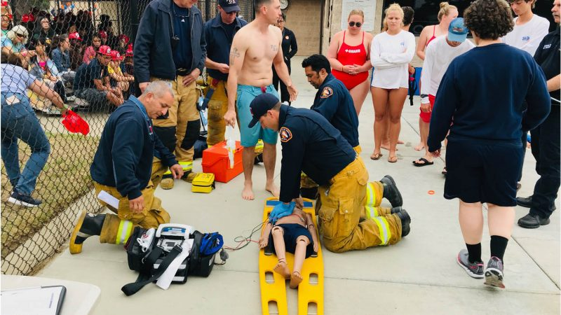 Firefighter demonstrating CPR.