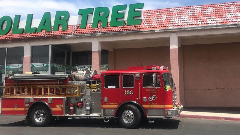 Fire truck in front of a dollar tree store.
