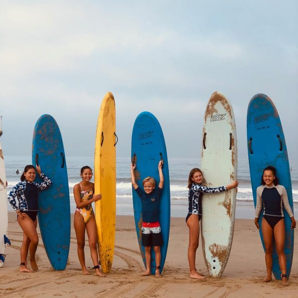 Junior Lifeguard Group Photo with surfboards.