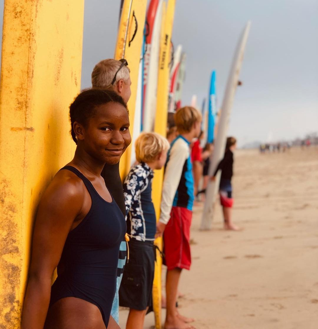 young women smiling for a photo who is part of the Junior Lifeguard.