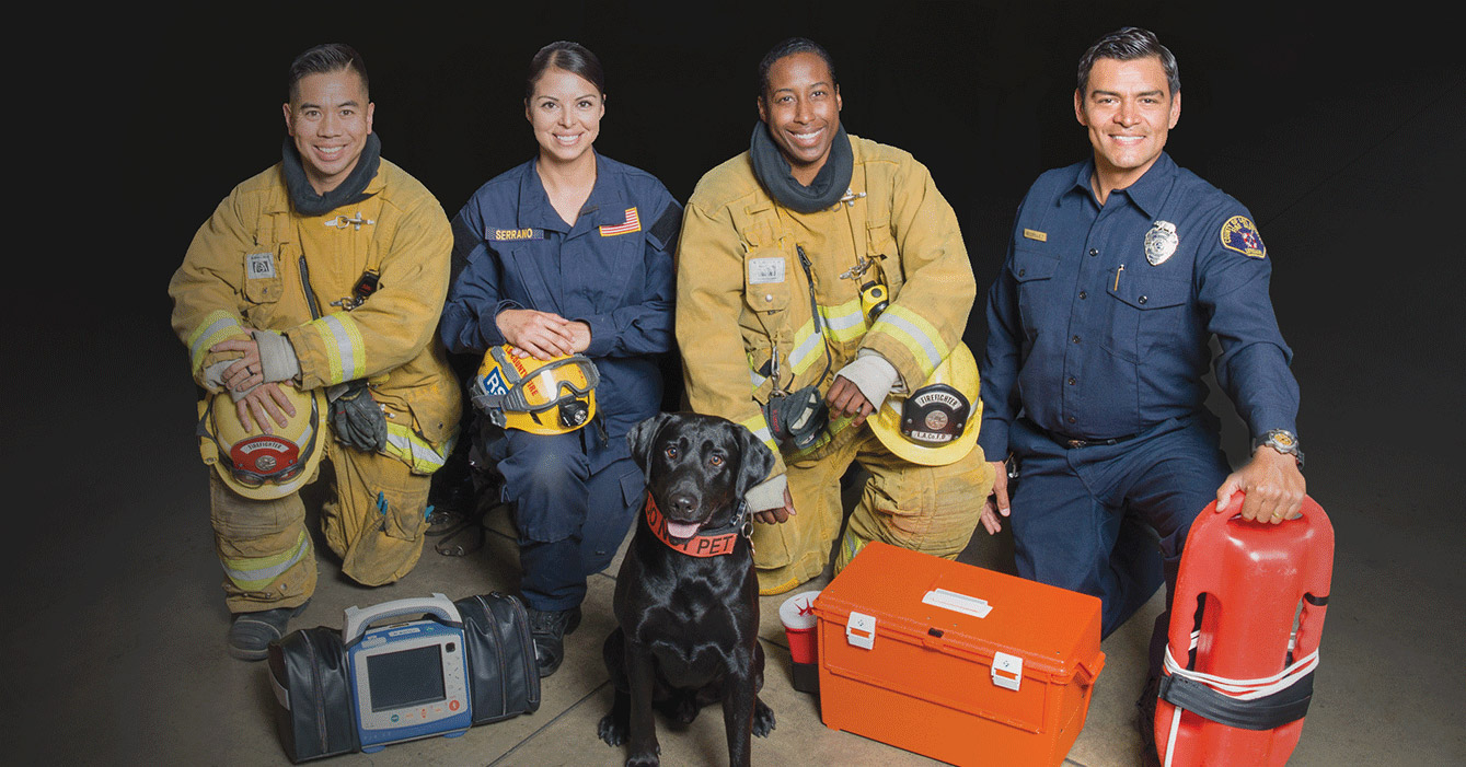Fire fighter picture with dogs.
