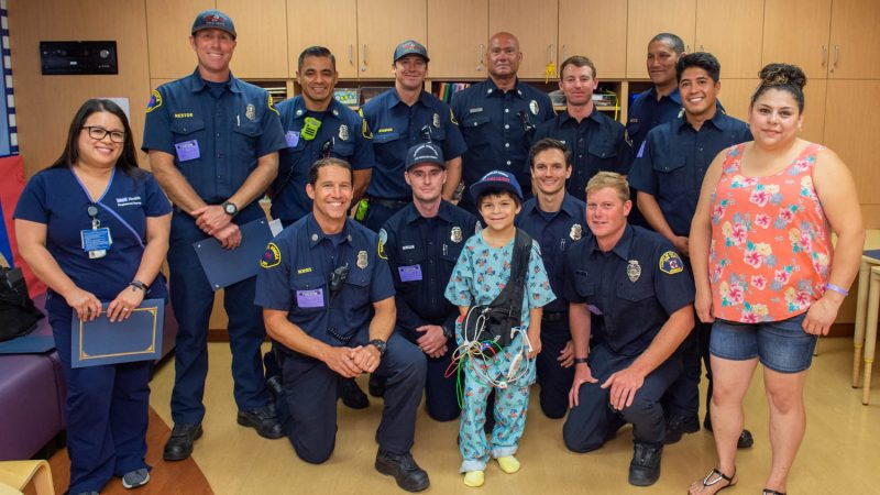 Seven Year old reunites with Lifeguard group photo.