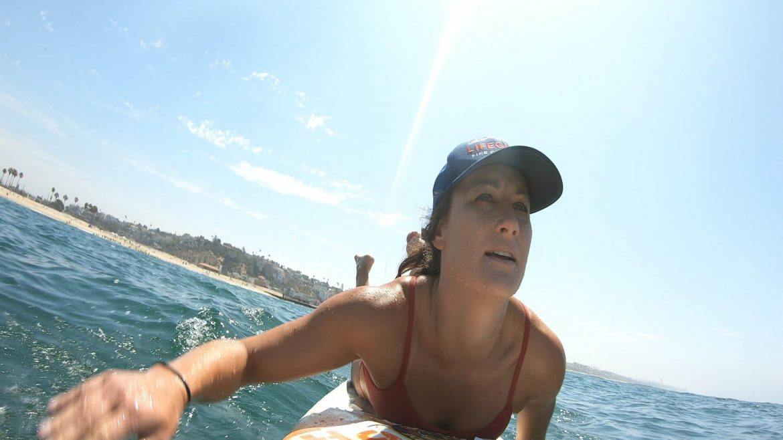 Lifeguard paddling in the ocean.
