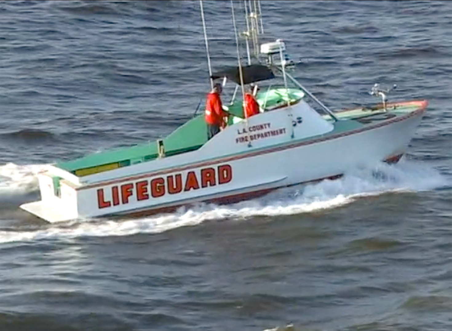 Image of a lifeguard boat in the water.