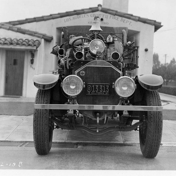Front image of a history Photo of an older fire engine.