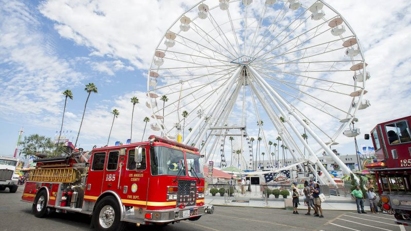 Fire truck with a ferris wheel in the background.