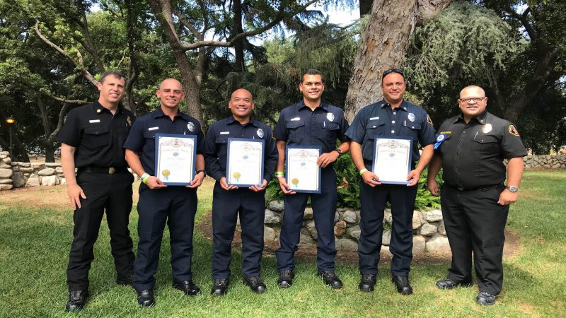 Group photo of firefighters receiving awards at the LA County Fair.